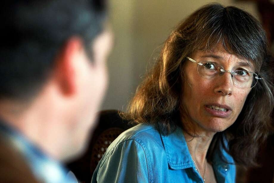 """Former tea party activist, Mark Meckler, talks to MoveOn.org co-founder, Joan Blades, during a 2013 """"Living Room Conversation"""" in Berkeley. Photo: Sean Havey, The Chronicle"""
