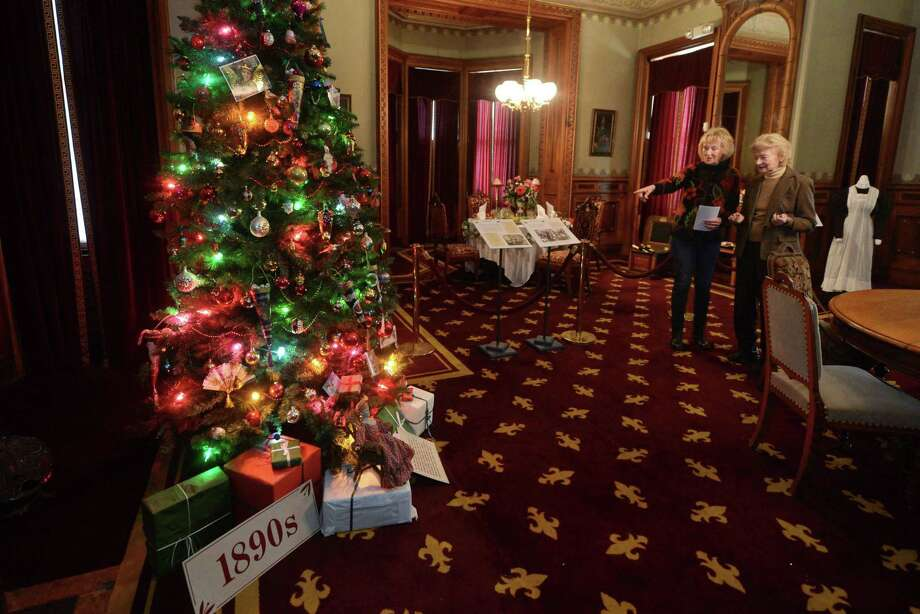 Mimi Findlay, the co-chair of the Curatorial Committee at The Lockwood-Mathews Mansion Museum, gives a sneak preview of The Museum's exhibit on holiday traditions from the 1860s through the 1930s Tuesday, November 21, 2017,  in Norwalk, Conn. Findlay designed the 1930s tree and display including the lights and the doll which come from her own childhood. Photo: Erik Trautmann / Hearst Connecticut Media / Norwalk Hour