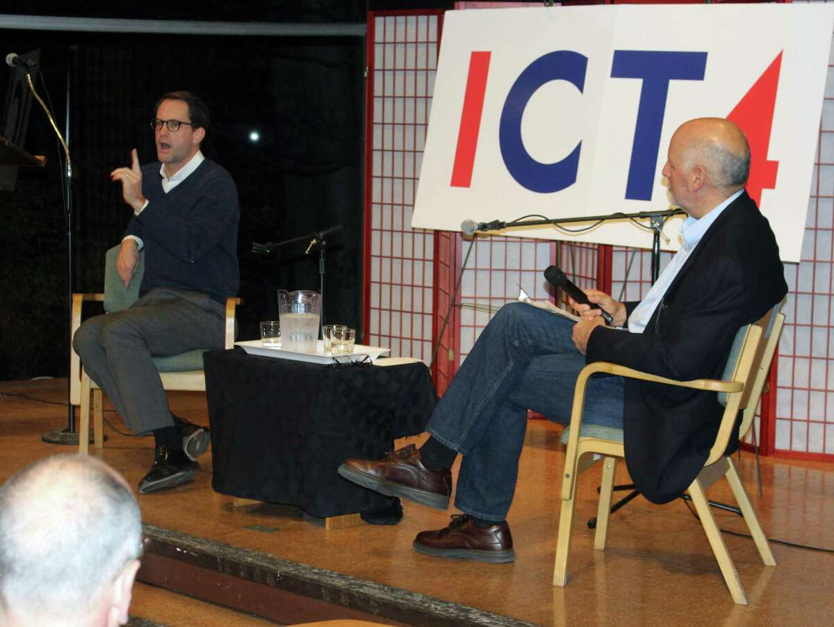 Rep. Jim Himes, D-Conn., left, spoke at the the Unitarian Church of Westport on the night of Nov. 21.