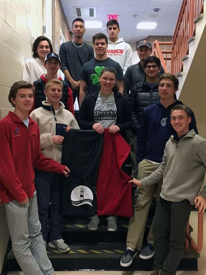 """The entrepreneurship class of Fairfield Warde business teacher Allyson Danso and one of their """"Baller Blankets."""" Photo: Contributed Photo / Fairfield Citizen"""