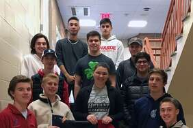 "The entrepreneurship class of Fairfield Warde business teacher Allyson Danso and one of their ""Baller Blankets."""