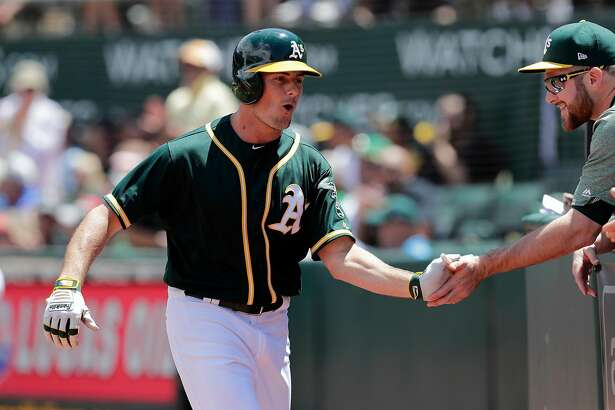 A's Jaycob Brugman after a solo home run in the 4th inning, as the Oakland Athletics take on the Chicago White Sox at the Oakland Coliseum on Wednesday July 5, 2017, in Oakland, Ca.