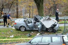 A silver BMW sits on the side of Washington Boulevard after being involved in a single car accident in downtown Stamford, Conn. on Wednesday, Nov. 22, 2017.
