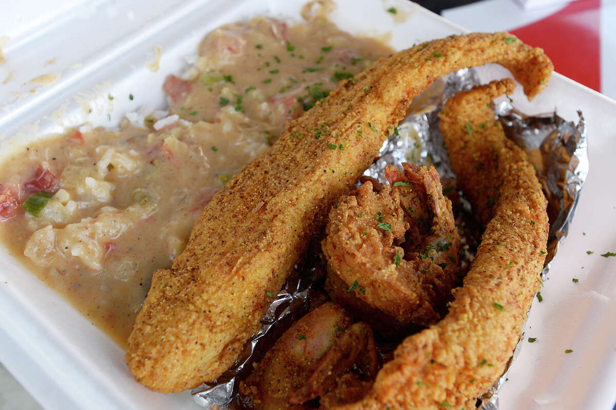 Fried fish and fried shrimp with rice and a seafood cream sauce from the Me So Hungry food truck. Photo taken Wednesday 11/15/17 Ryan Pelham/The Enterprise