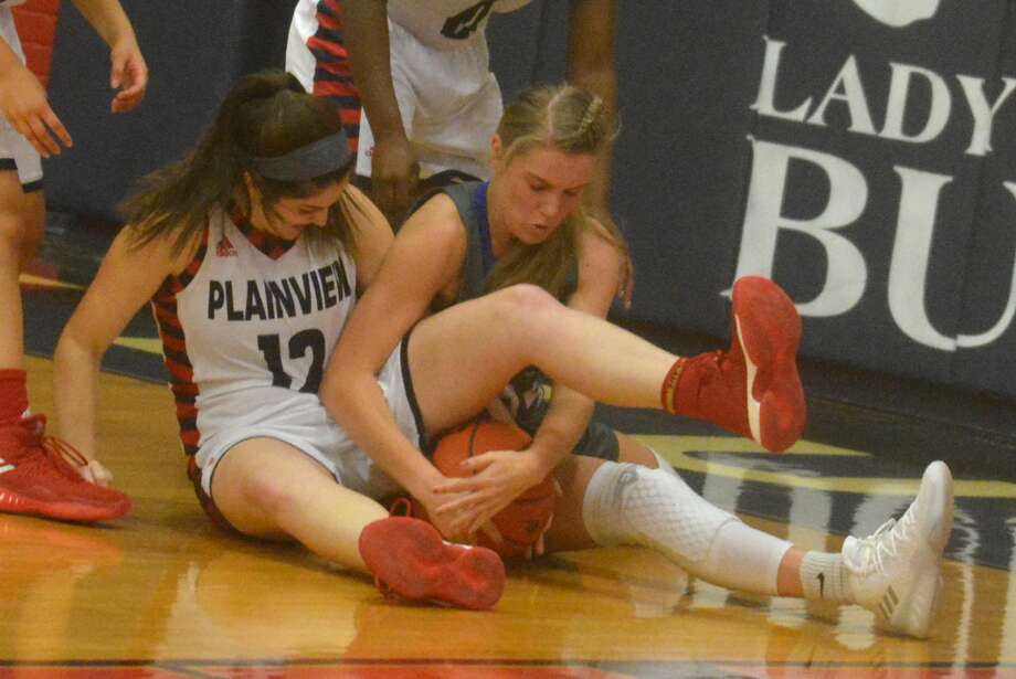 Plainview's Lauren Pritchard, 12, gets tangled up with a Frenship player as they battle for possession of the ball during a game at the Plainview High School gym Tuesday night. Photo: Skip Leon/Plainview Herald