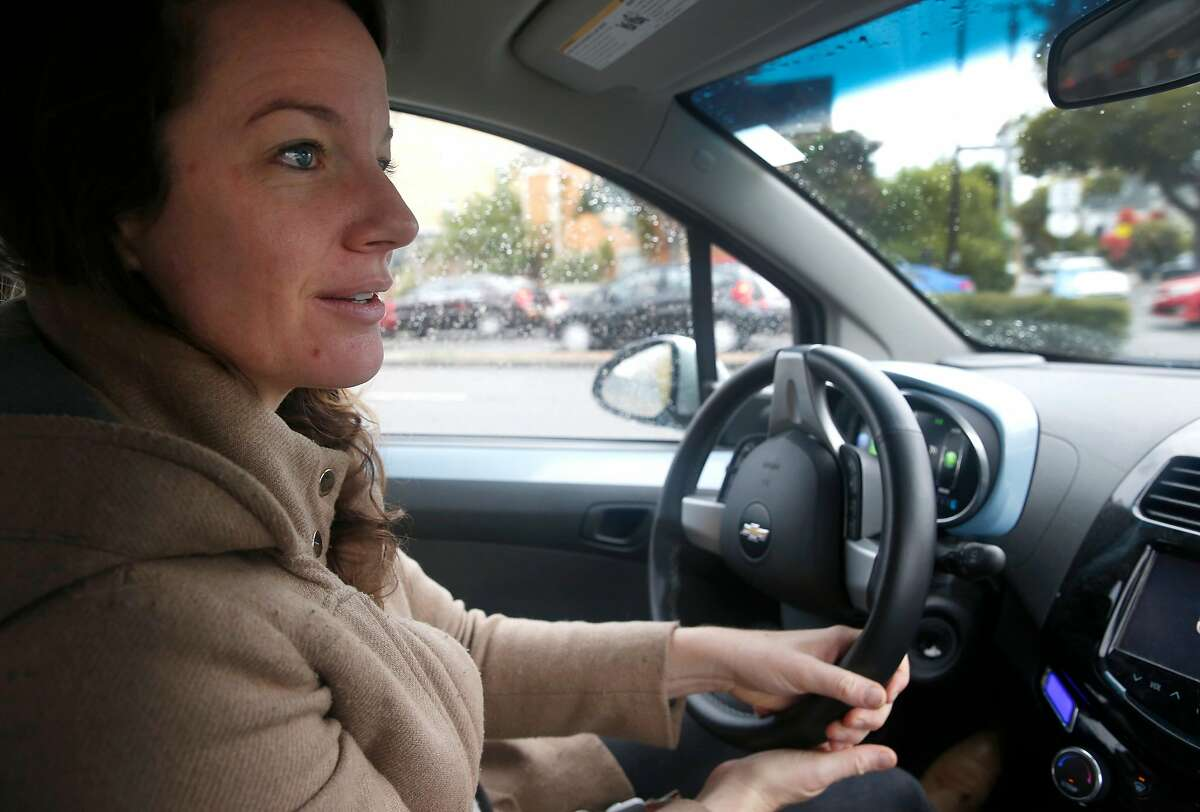 Amy Hale drives her Chevrolet Spark electric vehicle after recharging it overnight in front of her home in Berkeley, Calif. on Wednesday, Nov. 15, 2017. Amy Hale and her fianc� Bernhard Haux are participating in a pilot project by the city of Berkeley which is permitting a limited number of curbside charging stations for residents enrolled in the program.