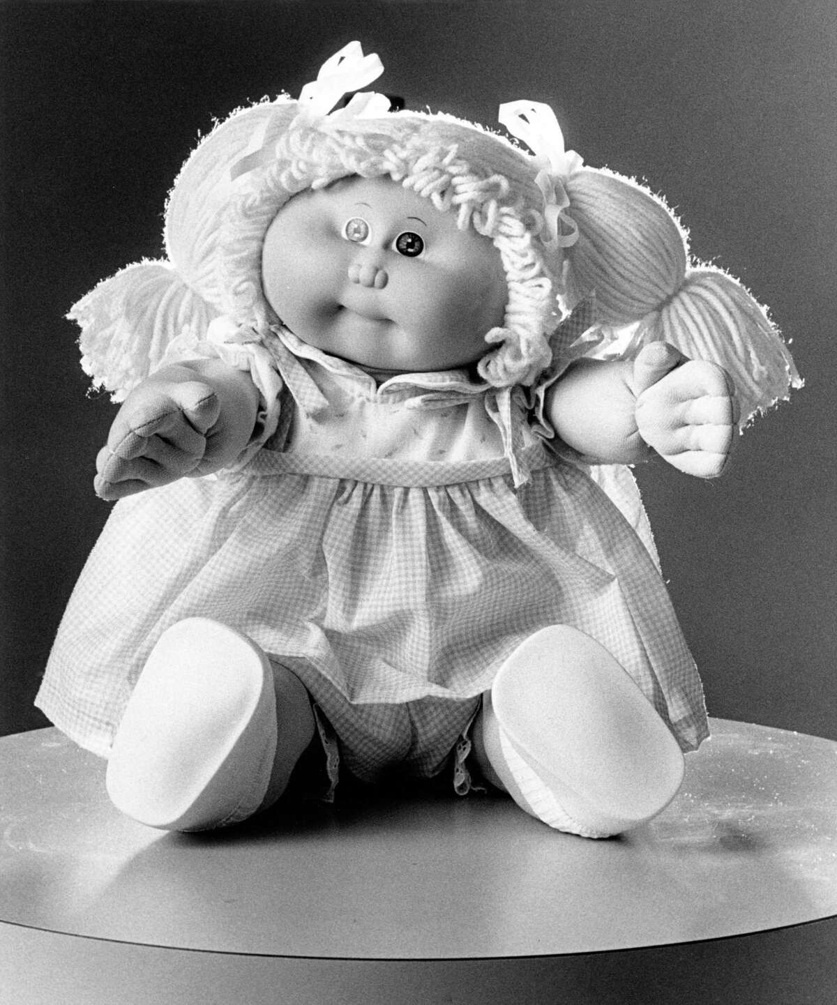 """11/25/1983 - Cabbage Patch Kids doll """"Mae Raina"""" comes with adoption papers and a birth certificate."""