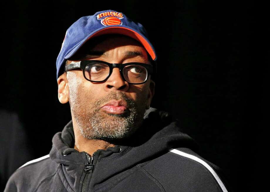 "FILE - This April 29, 2014 file photo shows filmmaker and avid basketball fan Spike Lee at a news conference by NBA Commissioner Adam Silver in New York announcing that Los Angeles Clippers owner Donald Sterling has been banned for life by the league. Lee says his wife convinced him to turn his 1986 film ""She's Gotta Have It"" into a television series for Showtime. The original story focused on a woman's relationship with three men, exploring the issues of race, sexuality and gentrification in the neighborhood of Brooklyn. Showtime will decide whether the show gets picked up or not. (AP Photo/Kathy Willens, FIle) ORG XMIT: NYET705 Photo: Kathy Willens / AP"