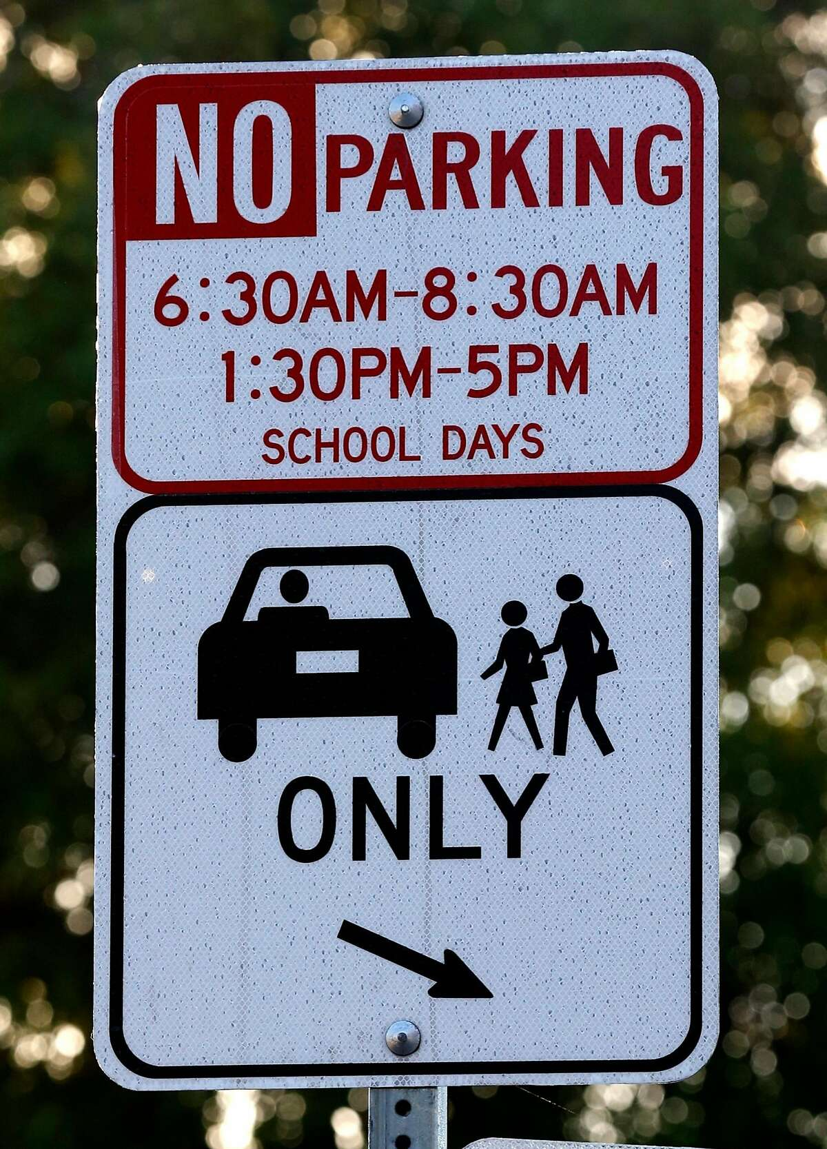 A special drop-off zone is designated for parents of Glenview Elementary School students on East 38th and Beaumont avenues in Oakland, Calif. on Friday, Nov. 17, 2017. Students are being bused to Santa Fe Elementary in North Oakland during reconstruction of their school. Delays and increased costs in the reconstruction of Glenview Elementary have angered parents and residents.