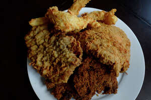 A plate with fried chicken, chicken-fried steak, fried catfish and chicken-fried chicken at Republic Chicken in Beaumont. The restaurant is at the corner of 5th Street and Hazel Avenue in Old Town.  Photo taken Tuesday 10/11/16 Ryan Pelham/The Enterprise