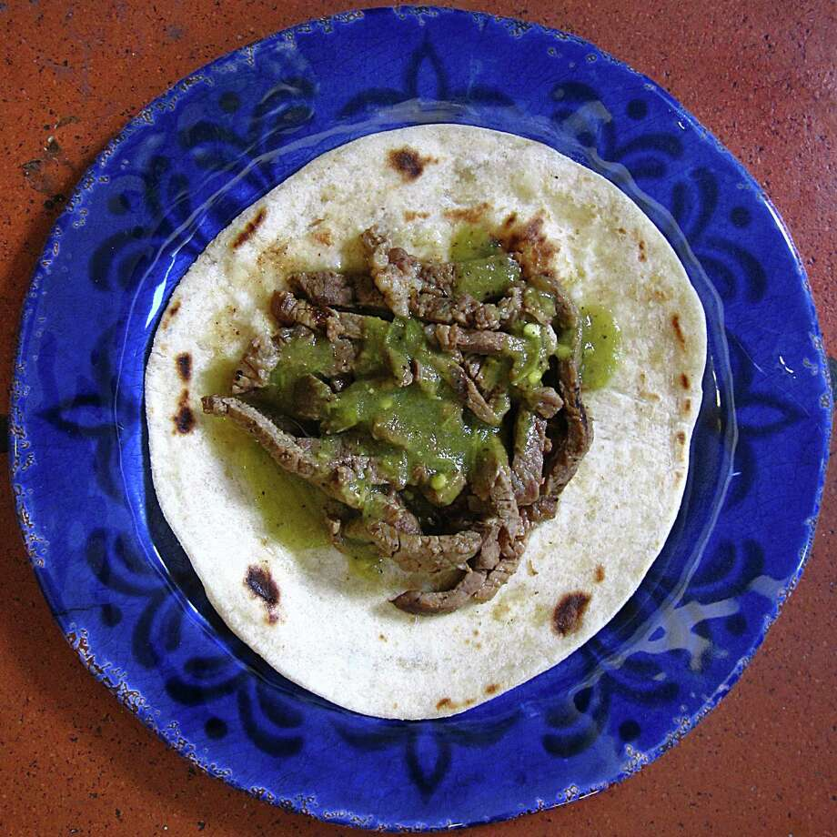 Al carbon taco on a handmade flour tortilla from La Parrilla Azteca. Photo: Mike Sutter /San Antonio Express-News