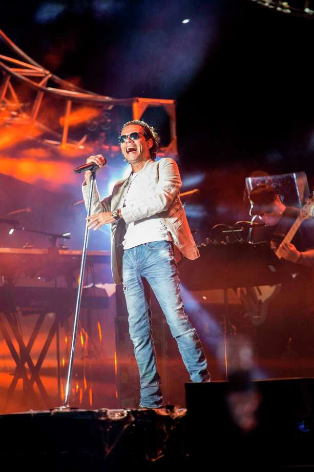 """Puerto Rican singer Marc Anthony performs during the Festival """"Presidente"""" at the Estadio Olimpico in Santo Domingo, Dominican Republic, on 03 November 2017.  / AFP PHOTO / Erika SANTELICESERIKA SANTELICES/AFP/Getty Images Photo: ERIKA SANTELICES, Contributor / afp"""