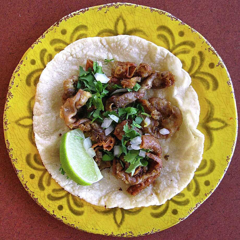 Tripas taco on a handmade corn tortilla from Gibby's La Cocina. Photo: Mike Sutter /San Antonio Express-News