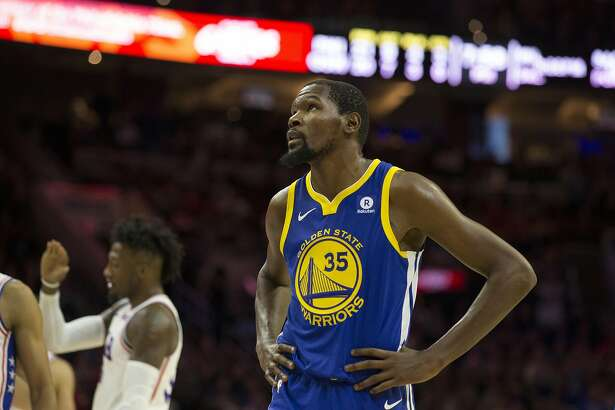 PHILADELPHIA, PA - NOVEMBER 18: Kevin Durant #35 of the Golden State Warriors looks on against the Philadelphia 76ers in the first half at Wells Fargo Center on November 18, 2017 in Philadelphia,Pennsylvania. NOTE TO USER: User expressly acknowledges and agrees that, by downloading and or using this photograph, User is consenting to the terms and conditions of the Getty Images License Agreement. (Photo by Rob Carr/Getty Images)