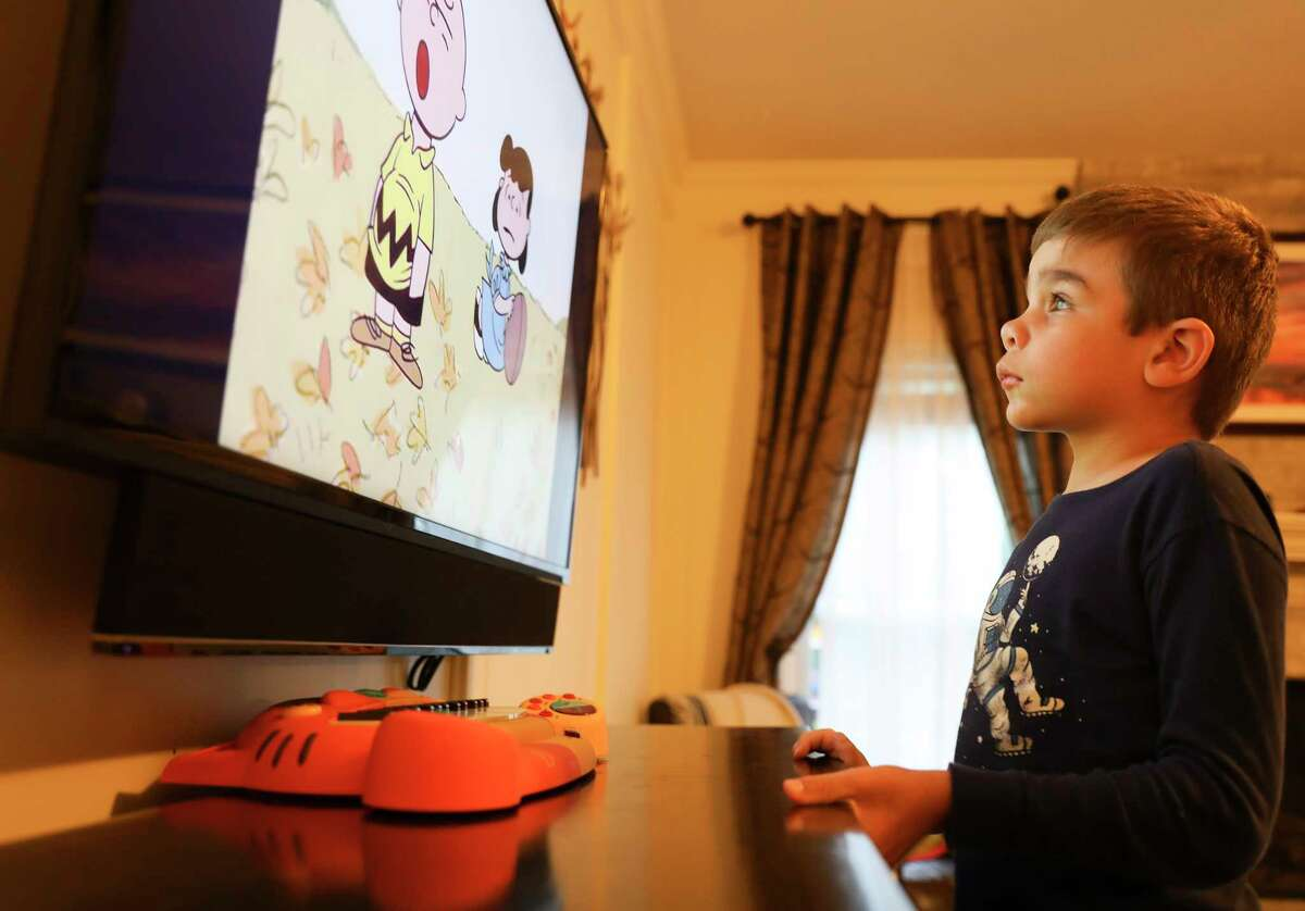 Will Byers, 7, watches Charlie Brown in his home on Saturday, Sept. 30, 2017, in Spring. Will was diagnosed withSanfilippoSyndrome, a rare, genetic disorder that slowly destroys his body. After being given the hope of a spot in a clinical trial for a drug that seemed to be helping slow down the disease, Will's parents were crushed by the sudden cancellation of the drug trial. ( Elizabeth Conley / Houston Chronicle )