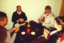 Volunteers in period dress play whist – a once popular card game – with guests at last year's Stephenson House Candlelight Tour.