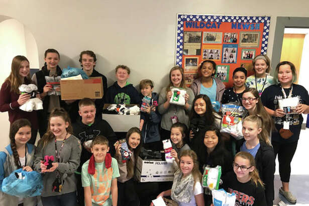 Students at Lincoln Elementary School collected 670 pairs of new or gently used socks for needy people. The sock drive was led by students from Carla Fink's honors language arts class.