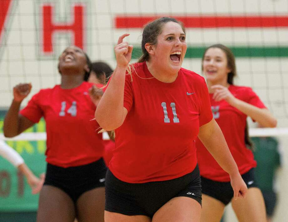 Oak Ridge's Carly Graham (11) celebrates after an ace by Shea Green during the second set of a District 12-6A high school volleyball match at The Woodlands High School, Tuesday, Oct. 10, 2017, in The Woodlands. Photo: Jason Fochtman, Staff Photographer / © 2017 Houston Chronicle