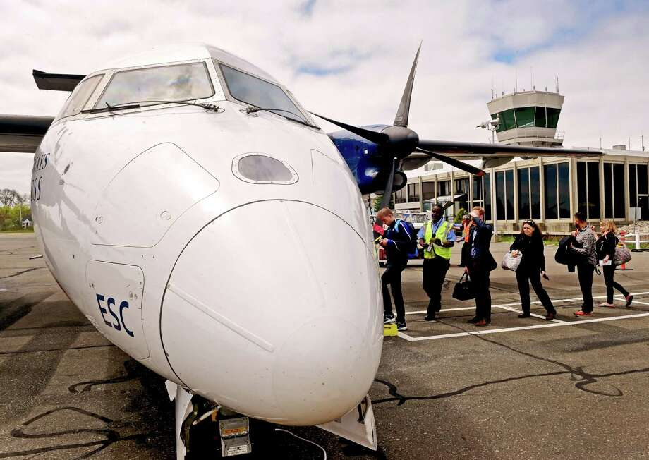 (Peter Hvizdak - New Haven Register) Passengers board a 37-seat Bombardier Dash 8 turboprop airplane at Tweed New Haven Regional Airport on April 27, 2017. The Dash 8s will be replaced by larger, faster 50-seat, American Eagle Canadair CRJ-200 regional jets on Nov. 29, 2017. Photo: Peter Hvizdak / ©2017 Peter Hvizdak / ©2017 Peter Hvizdak
