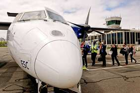 (Peter Hvizdak - New Haven Register) Passengers board a 37-seat Bombardier Dash 8 turboprop airplane at Tweed New Haven Regional Airport on April 27, 2017. The Dash 8s will be replaced by larger, faster 50-seat, American Eagle Canadair CRJ-200 regional jets on Nov. 29, 2017.