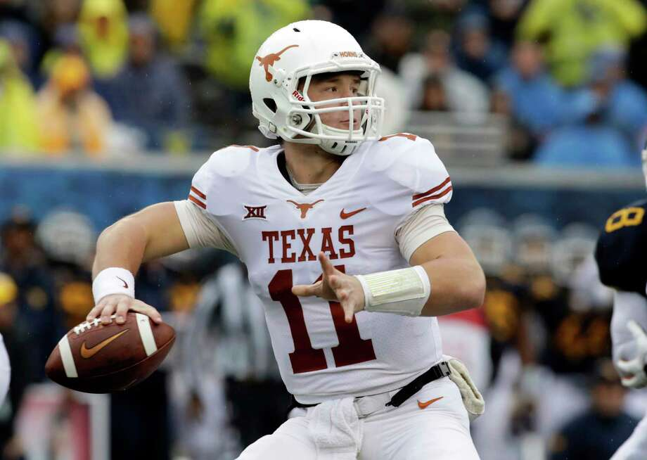 FILE - In this Saturday, Nov. 18, 2017, file photo, Texas quarterback Sam Ehlinger (11) throws a pass during the first half of an NCAA college football game against West Virginia in Morgantown, W.Va. Texas coach Tom Herman announced Monday that Sam Ehlinger will start against Texas Tech after he led the Longhorns to a 28-14 win at West Virginia in relief of Shane Buechele.  (AP Photo/Raymond Thompson, File) Photo: Ray Thompson, FRE / FR171247 AP