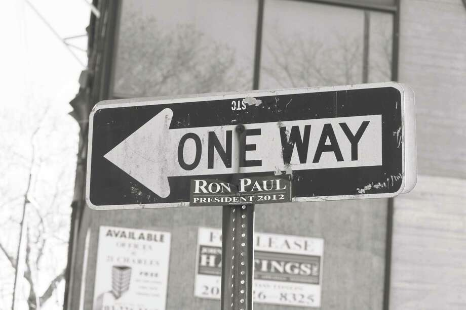 In Saugatuck, a campaign sign for 2012 Presidential hopeful Ron Paul still hangs on a street sign, five years later. Photo: Justin Papp / Hearst Connecticut Media