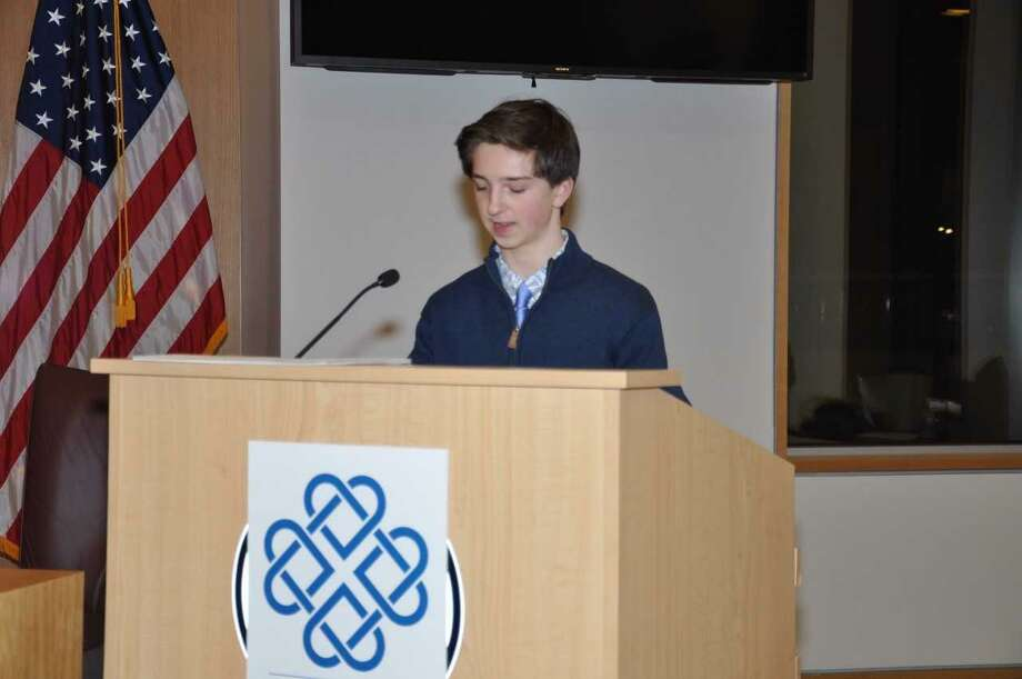 "Logan Diliberto, winner of the ""Youth MVP"" award speaks about the value of volunteering at the 2017 Volunteer Recognition Awards hosted by the New Canaan Community Foundation in New Canaan, Conn. on Nov. 16, 2017 Photo: Contributed Photo / Contributed Photo / New Canaan News contributed"