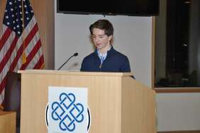 "Logan Diliberto, winner of the ""Youth MVP"" award speaks about the value of volunteering at the 2017 Volunteer Recognition Awards hosted by the New Canaan Community Foundation in New Canaan, Conn. on Nov. 16, 2017"