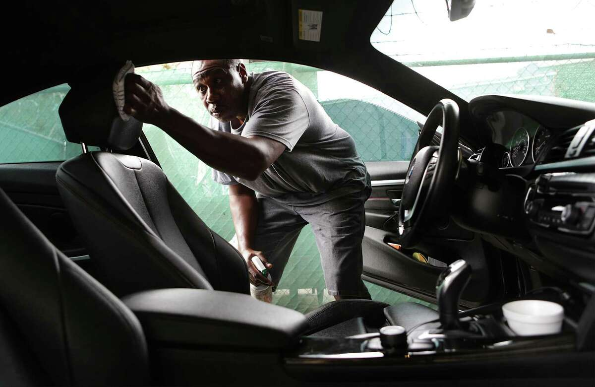 Vincent Matthews received support from the De Novo Foundation to start his business, Vincent Anointed Hand Detail, which operates out of Broadway Tire. He details a vehicleon Nov. 14, 2017.
