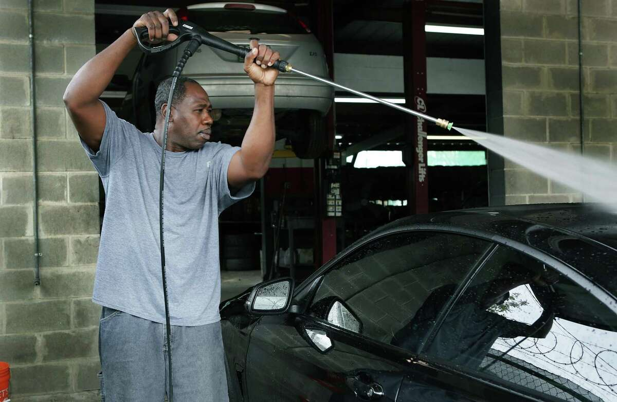 Vincent Matthews runs his Vincent Anointed Hand Detail business out of Broadway Tire, on Tuesday, Nov. 14, 2017. Matthews received support from De Novo Foundation to help start his business.