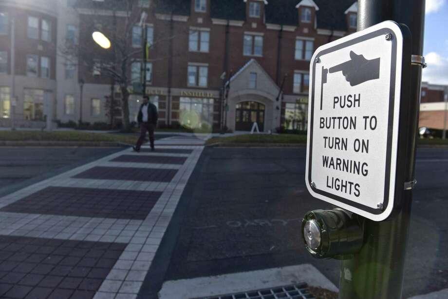 The city has been installing new crosswalks downtown with enhanced digital lighting. Crosswalk across Main Street at Center Street. Monday, November 20, 2017, in Danbury, Conn. Photo: H John Voorhees III / Hearst Connecticut Media / The News-Times