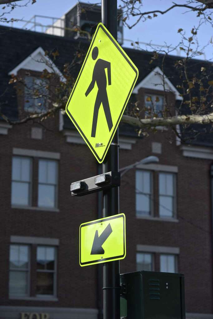 installing signage on high rise new technology makes connecticut crosswalks safer newstimes