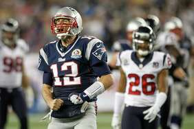 New England Patriots quarterback Tom Brady (12) lets out celebratory yell during the second half of a Monday Night Football game at Gillette Stadium on Monday, Oct. 8, 2012, in Foxborough, Mass. ( Brett Coomer / Houston Chronicle )