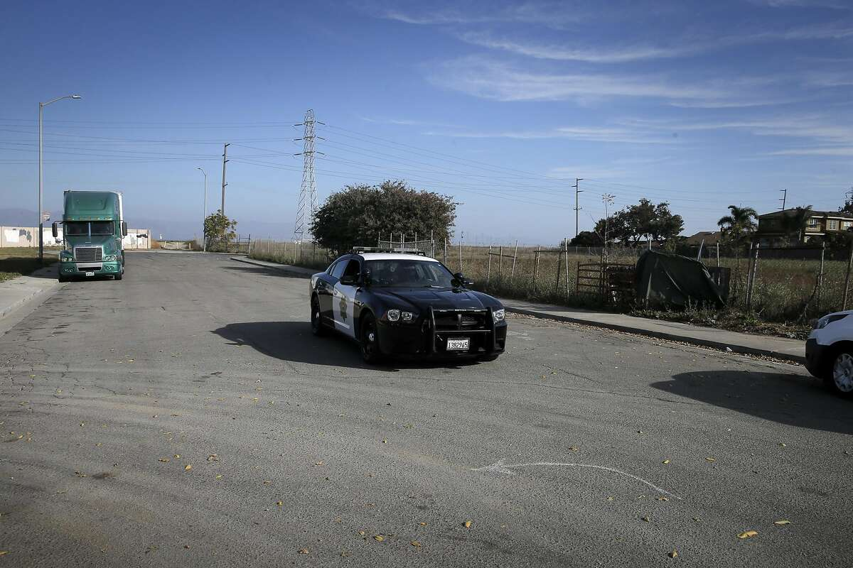 An East Palo Alto police cruiser drives by on Weeks Street. The street is the future site of a multi-million dollar private school funded by Facebook founder Mark Zuckerberg, and it was the site of protests about RV removals on November 15.