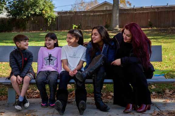 From left: Danyal Nasseri, 7, with his siblings Iman, 9, Jennah, 12, Diana, 14, and mother Habiba at the park on Saturday, Nov. 18, 2017, in Santa Clara, Calif. Habiba participated in a study to share her genetic data with UCSF and Color Genomics.