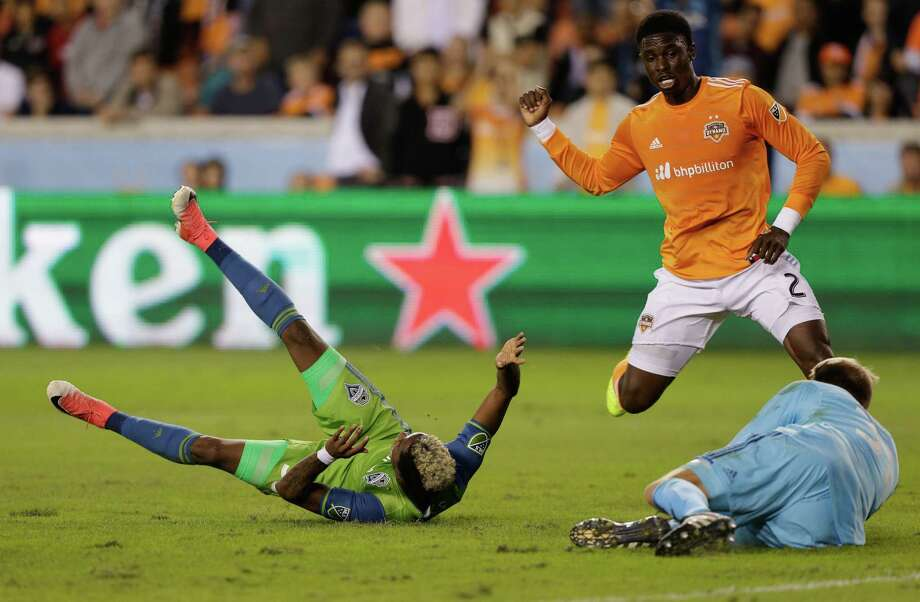 HOUSTON, TX - NOVEMBER 21:  Joevin Jones #33 of Seattle Sounders is tackled in the penalty area by Jalil Anibaba #2 of Houston Dynamo in the  first half at BBVA Compass Stadium on November 21, 2017 in Houston, Texas. Anibaba was issued a red card for the penalty. Photo: Bob Levey, Getty Images / 2017 Getty Images