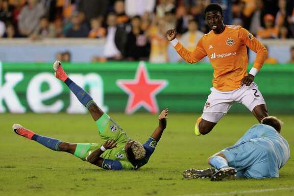 HOUSTON, TX - NOVEMBER 21:  Joevin Jones #33 of Seattle Sounders is tackled in the penalty area by Jalil Anibaba #2 of Houston Dynamo in the  first half at BBVA Compass Stadium on November 21, 2017 in Houston, Texas. Anibaba was issued a red card for the penalty.