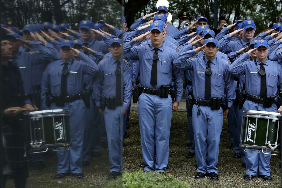 San Antonio Police Academy cadets salute during the Tribute to the San Antonio Police Department's Fallen Officers at the San Antonio Police Training Academy on May 10. Among the items the community can be thankful for: its first responders. Photo: Lisa Krantz /San Antonio Express-News / ©2017 San Antonio Express-News