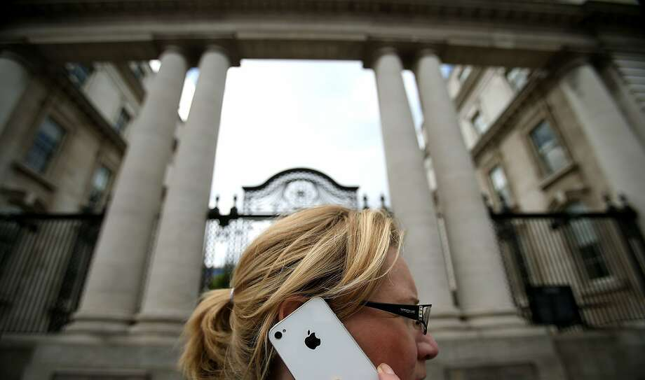 A woman speaks on her iPhone in Ireland, where Apple reportedly has diverted nearly two-thirds of its pretax revenue. Photo: Julien Behal - PA Images, PA Images Via Getty Images