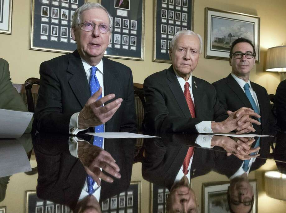 Senate Majority Leader Mitch McConnell (from left), Senate Finance Committee Chairman Orrin Hatch, Treasury Secretary Steven Mnuchin and others should recognize that graduate education is in an investment in the U.S. economy. Photo: J. Scott Applewhite /Associated Press / Copyright 2017 The Associated Press. All rights reserved.