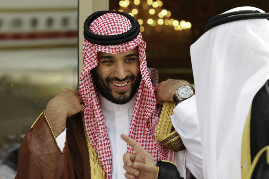 Prince Mohammed bin Salman speaks with a Saudi prince in 2012. He has acted to consolidate power after he was named crown prince this year and the U.S. has given the green light. Photo: Hassan Ammar /Associated Press / Copyright 2017 The Associated Press. All rights reserved.