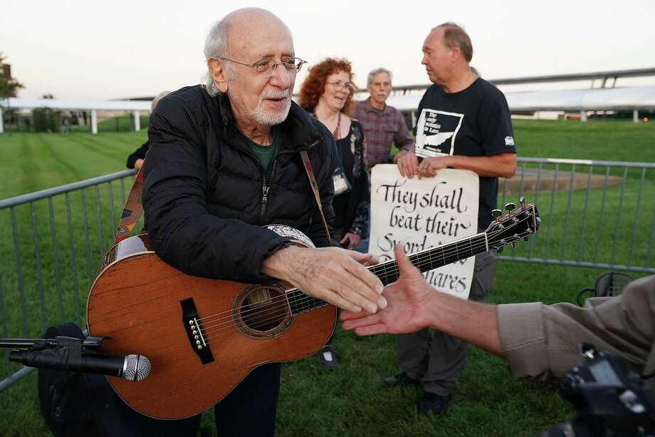 Peter Yarrow, a member of the legendary folk group Peter, Paul and Mary, sings and speaks about the 1967 March on the Pentagon during the 50th anniversary of the protest outside the Pentagon on Oct. 20. A reader says the Vietnam era is not so different from our own. Photo: Chip Somodevilla /Getty Images / 2017 Getty Images