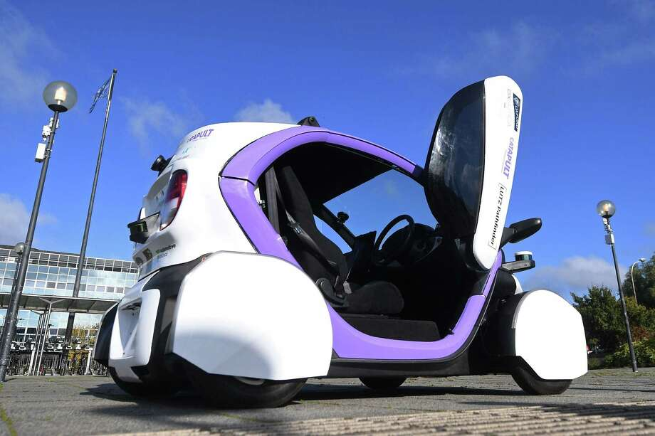Driveless cars such as this one, shown in 2016 north of London, will someday save Americans from their own self-destructive behavior. Until then, however, the U.S. could do more to make cars and driving safer. Photo: JUSTIN TALLIS /AFP /Getty Images / AFP or licensors