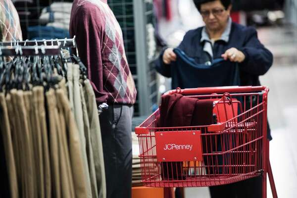 Only 10 percent of all retail purchases are made online. That, however, doesn't mean that brick-and-mortar stores can't do more to insulate themselves from loosing customers. Here a woman shops at a J.C. Penney Co. in Queens New York, Nov. 20.