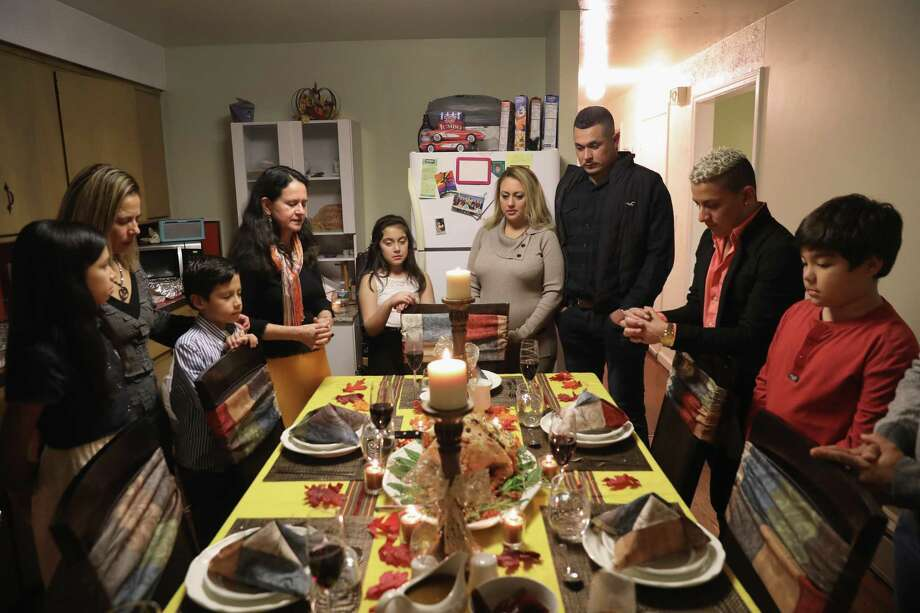 Last year, when these families gatherered for Thanksgiving, politics threatened the holiday harmony. Who knew Donald Trump's election would unify us a year later? Photo: Getty Images File Photo / 2016 Getty Images