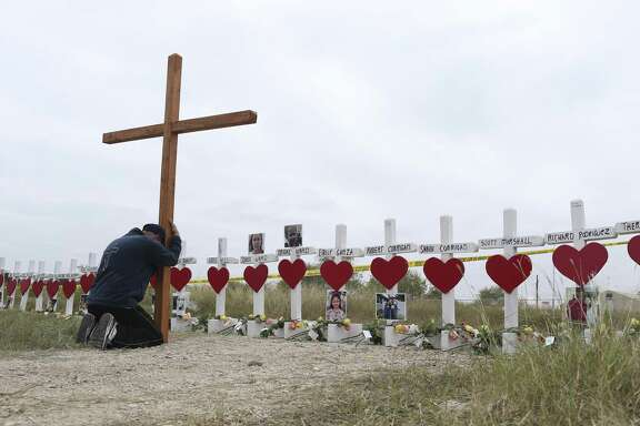 A mourner kneels by a memorial for the victims of the Sutherland Springs First Baptist Church mass shooting. Readers continue to express their sorrow over the tragedy.