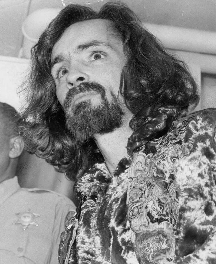 Charles Manson on Jan. 14, 1970, headed to appear before Judge George M. Dell, who granted him continuance to enter a plea. He died last week. Photo: Ben Olander /TNS / Los Angeles Times