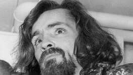 Charles Manson on Jan. 14, 1970, headed to appear before Judge George M. Dell, who granted him continuance to enter a plea. He died last week.