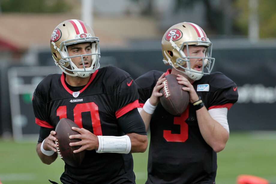 Jimmy Garoppolo (l to r), 49ers quarterback, and C.J. Beathard, 49ers quarterback practice with teammates at the Levi's Stadium practice field on Thursday, November 2, 2017 in Santa Clara, Calif. Photo: Lea Suzuki, The Chronicle