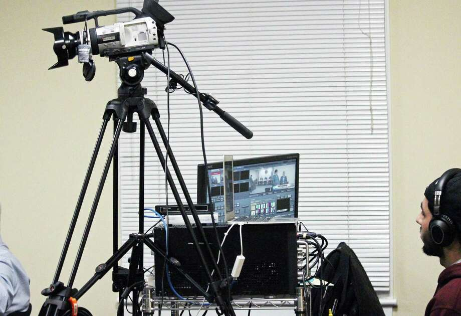 The cameras of FairTV have become a fixture at town meetings and events. Photo: Genevieve Reilly / Hearst Connecticut Media / Fairfield Citizen
